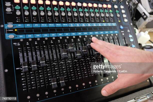 Cropped Image Of Dj Adjusting Sound Mixer