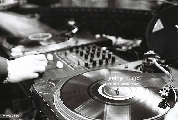 Cropped Image Of Dj Mixing Records