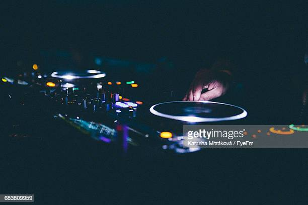 Cropped Image Of Dj Mixing Sound At Nightclub