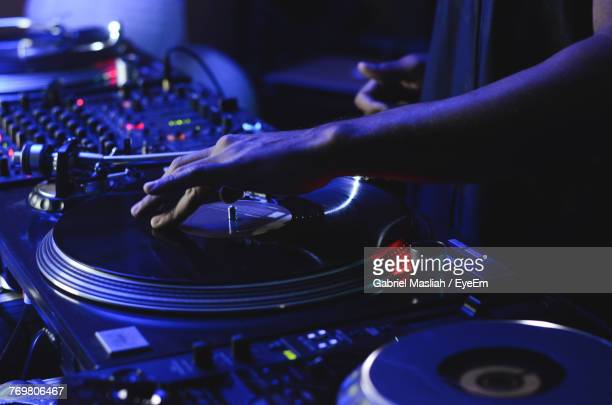 cropped image of dj playing music during concert - dj stock pictures, royalty-free photos & images