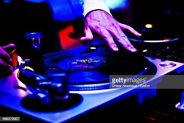 Cropped Image Of Dj Playing Music Turntable In Nightclub
