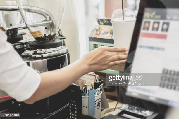 Cropped Image Of Female Barista Working In Coffee Shop