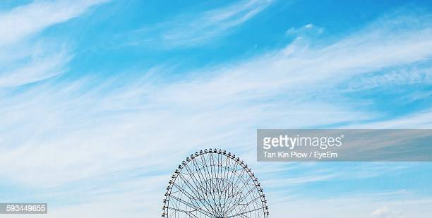 Cropped Image Of Ferris Wheel Against Sky