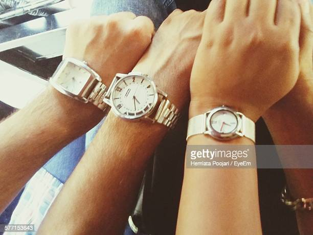 Cropped Image Of Friends Wearing Wristwatches