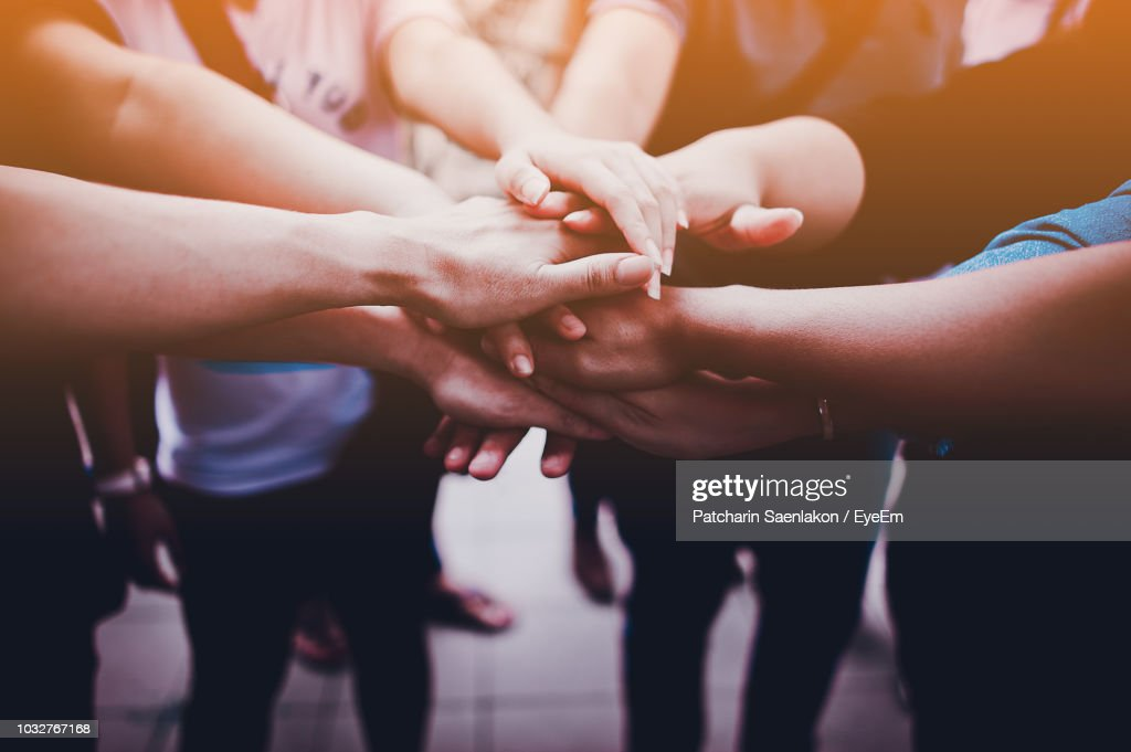 Cropped Image Of Friends With Stacked Hands Outdoors : Stock Photo