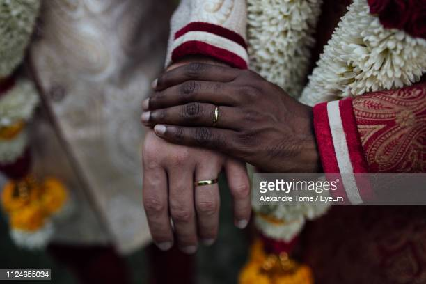 Cropped Image Of Gay Men Holding Hands During Wedding Ceremony