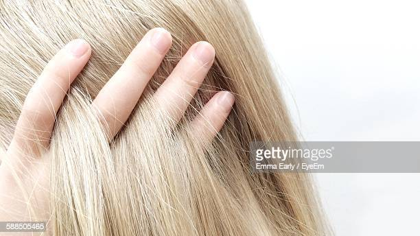 Cropped Image Of Girl With Hand In Blond Hair