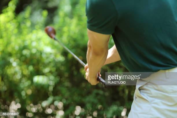 Cropped image of golfer swinging