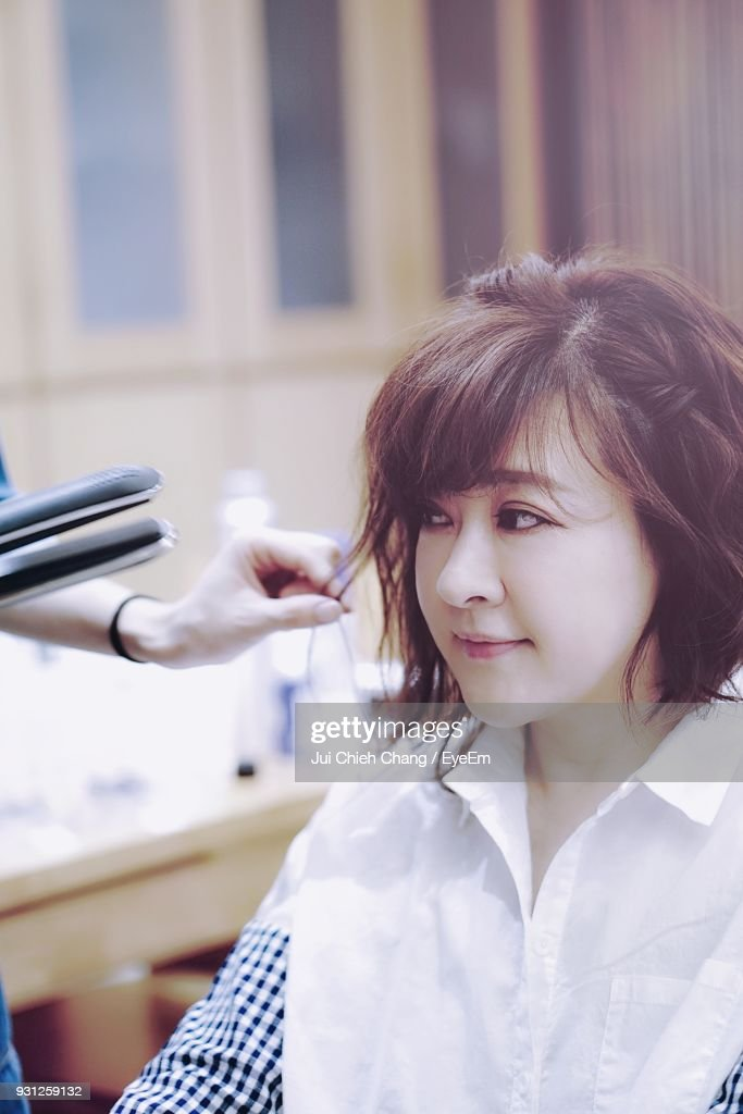 Cropped Image Of Hairdresser With Customer In Hair Salon : Stock Photo