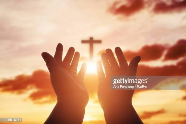cropped image of hand against sky - religion stock pictures, royalty-free photos & images