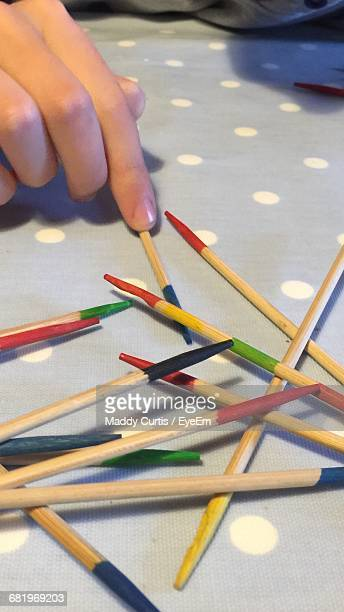 Cropped Image Of Hand And Pick Up Sticks
