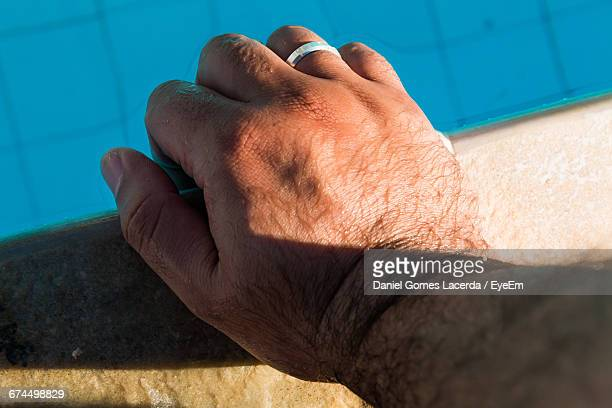 Cropped Image Of Hand At Poolside