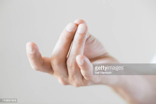 Cropped image of hand gesturing against white background