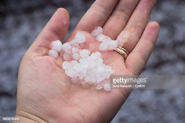 Cropped Image Of Hand Holding Hailstone