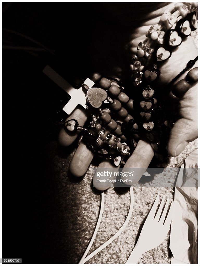 Cropped Image Of Hand Holding Rosary : Stock Photo