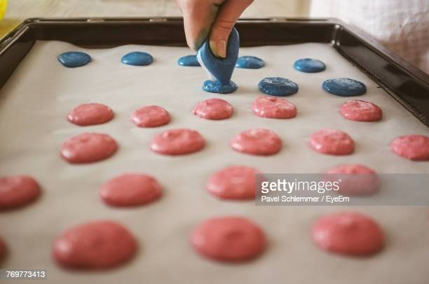 Cropped Image Of Hand Making Cookies In Baking Sheet