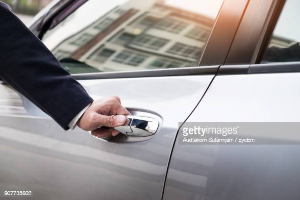 Cropped Image Of Hand Opening Car Door