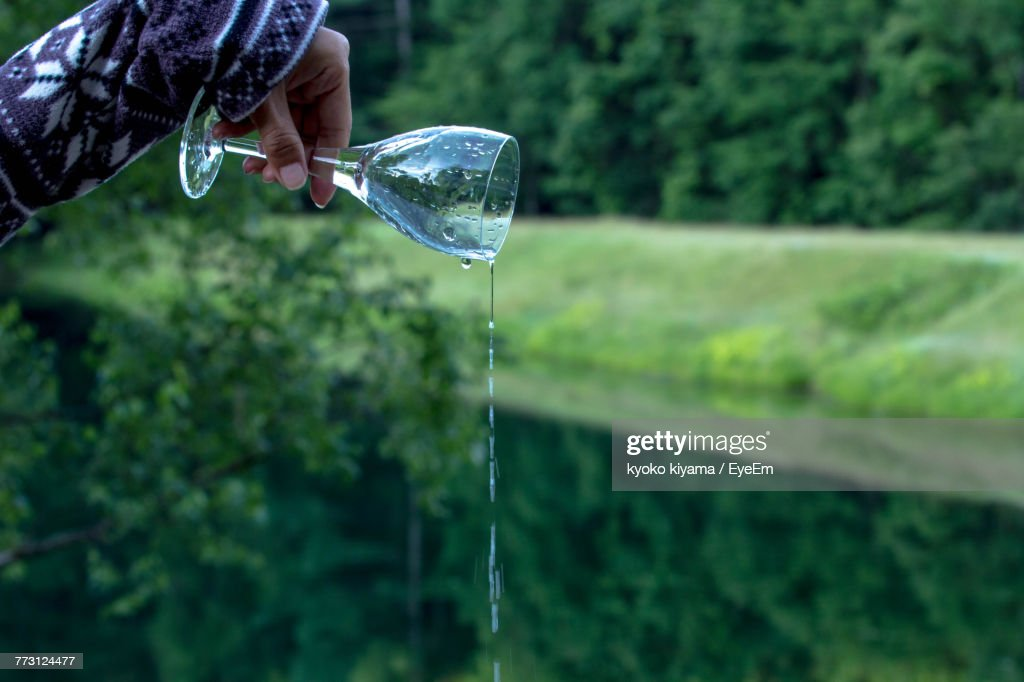 Cropped Image Of Hand Pouring Water : Photo