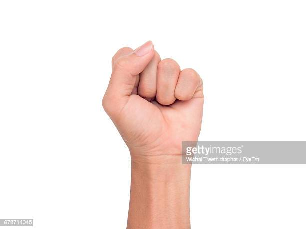 Cropped Image Of Hand Showing Fist Against White Background