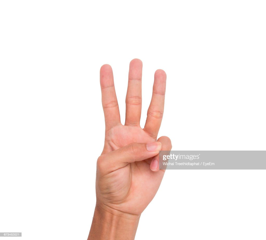 Cropped Image Of Hand Showing Three Fingers Against White Background : Stock Photo