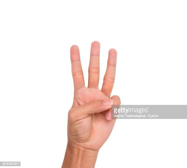 cropped image of hand showing three fingers against white background - menschlicher finger stock-fotos und bilder