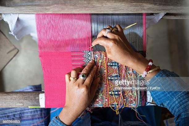 cropped image of hand weaving on handloom - loom stock pictures, royalty-free photos & images