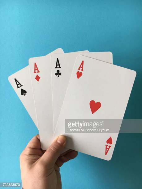 cropped image of hand with aces cards at casino table - four objects stock pictures, royalty-free photos & images