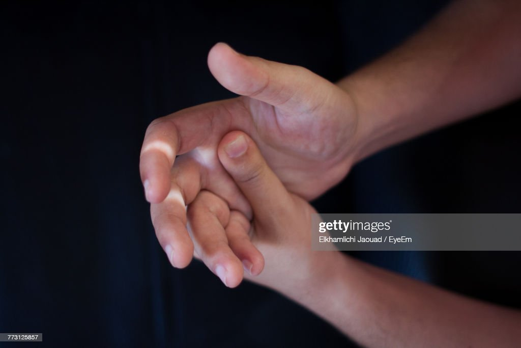 Cropped Image Of Hands Breaking Fingers : Photo