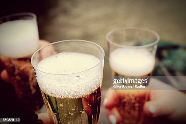 Cropped Image Of Hands Holding Champagne Flutes