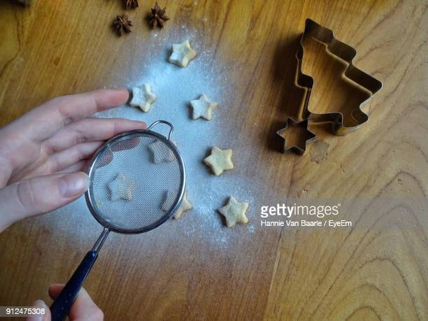 Cropped Image Of Hands Making Cookies During Christmas
