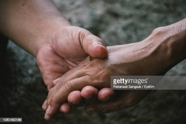 cropped image of hands - pattanasit stock pictures, royalty-free photos & images