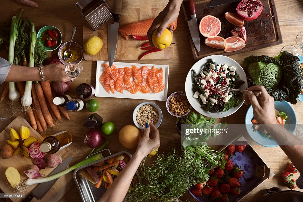 Cropped image of hands preparing food on table : Stock Photo