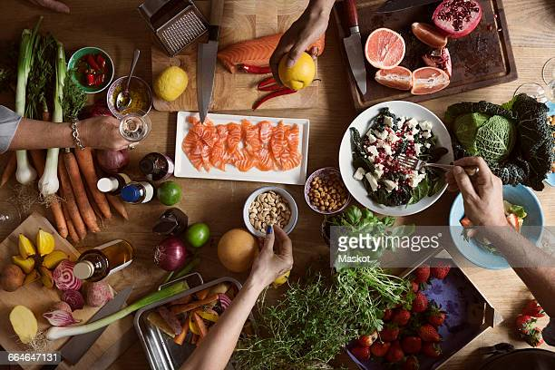cropped image of hands preparing food on table - nut food stock pictures, royalty-free photos & images