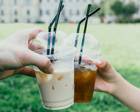 Cropped Image Of Hands Toasting Iced Coffee In Disposable Cups At Park - gettyimageskorea