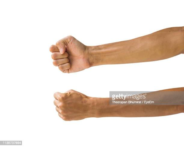 cropped image of hands with clenched fists against white background - 拳 ストックフォトと画像