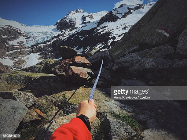 Cropped Image Of Hiker Holding Rope At Swiss Alps