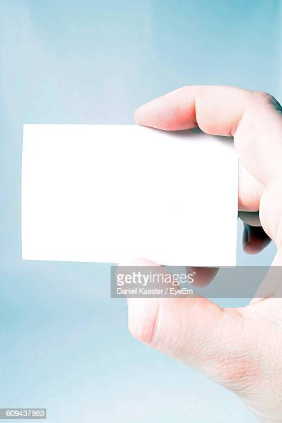Cropped Image Of Holding Blank Business Card