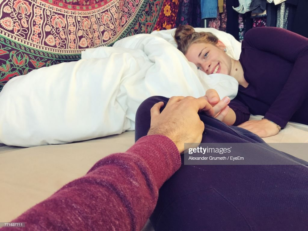 Cropped Image Of Holding Woman Hand Lying On Bed At Home : Stock-Foto