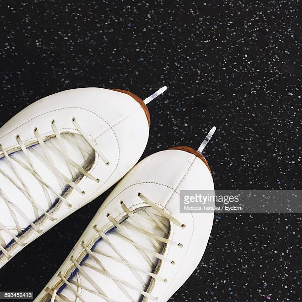 Cropped Image Of Ice Skates On Street