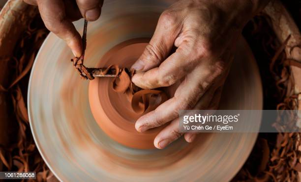 cropped image of making earthenware - sculptor stock pictures, royalty-free photos & images