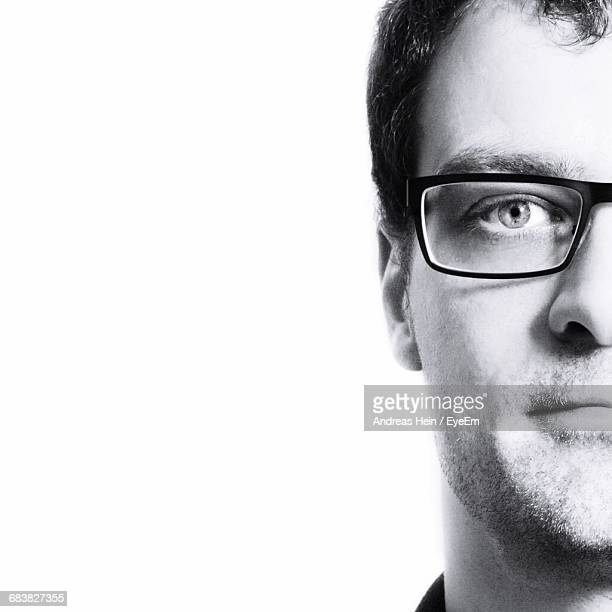 Cropped Image Of Man Against White Background