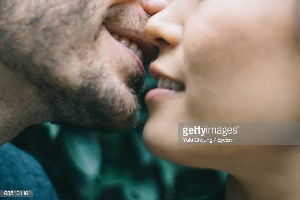 cropped image of man and woman embracing - coppia passione foto e immagini stock