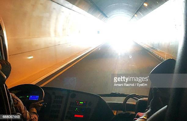 Cropped Image Of Man Driving Bus In Tunnel