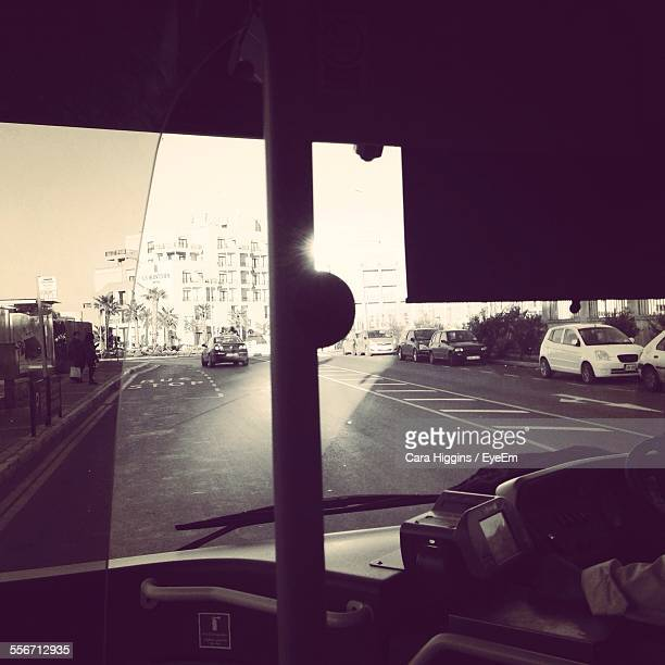 Cropped Image Of Man Driving Bus On City Street