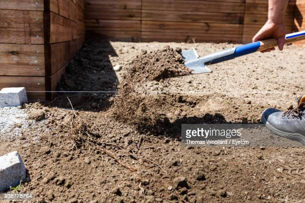 cropped image of man gardening in yard - digging stock pictures, royalty-free photos & images