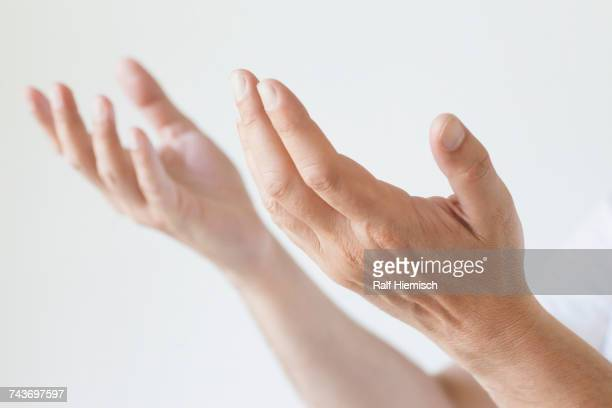 cropped image of man gesturing hands against white background - recevoir photos et images de collection