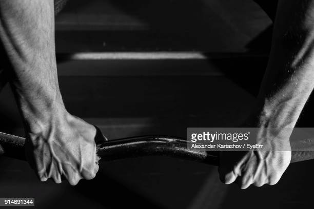 Cropped Image Of Man Gripping Horizontal Bar