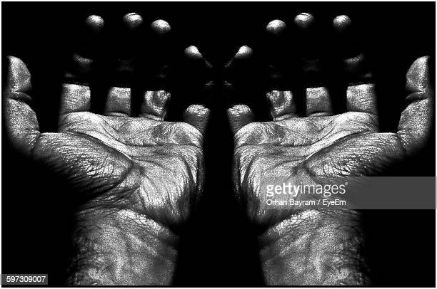 cropped image of man hands against black background - transferbild stock-fotos und bilder