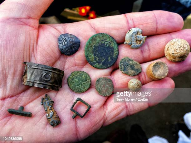 cropped image of man holding antiquities - antiquities stock pictures, royalty-free photos & images