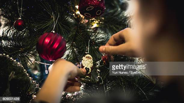 Cropped Image Of Man Holding Christmas Ornament